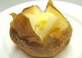 Baked Potatoes With Cheese Sauce
